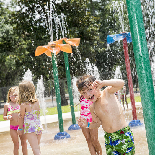 kids playing on a water splash pad