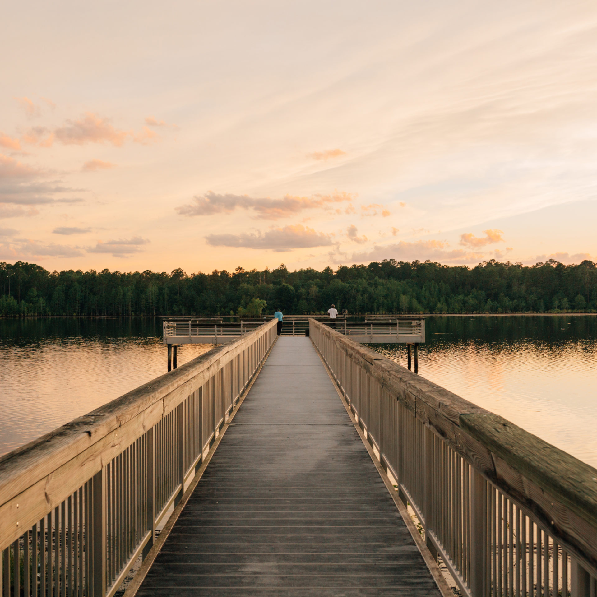 lake view with boardwalk and sunset